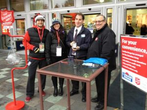 Salvation Army volunteers Sean and Laura join London Drugs store manager and Major Ken Ritson from the Salvation Army to launch pin pads donations.