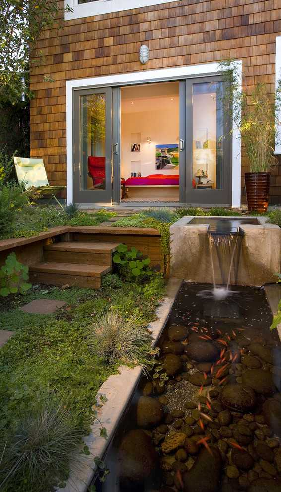 8 Beautiful Backyards to Drool Over - Koi Pond and Waterfall