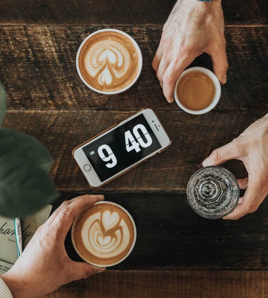 fika - coffee and an alarm clock on a table