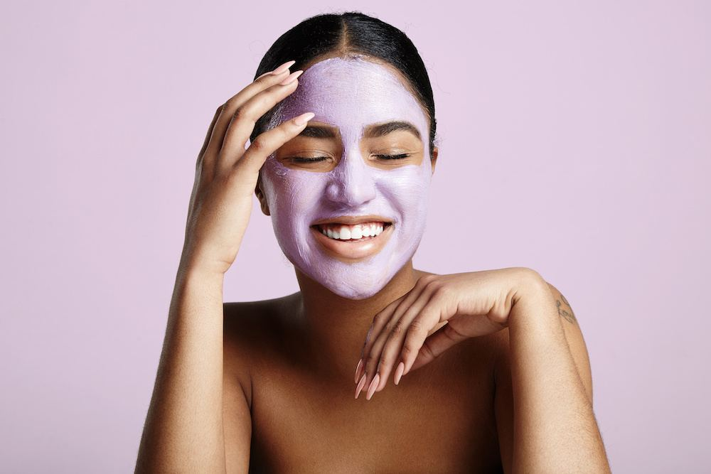 Woman smiling with face mask London Drugs Beauty