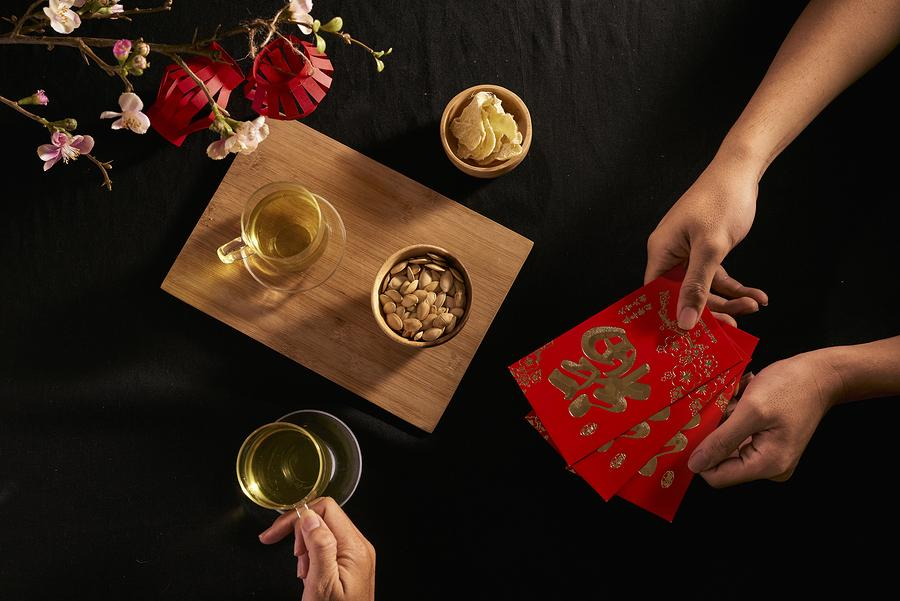 Chinese New Year Traditions Including Giving and Receiving Red Envelopes